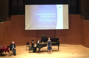 Veronika Anissimova and pianist Hye Jung Shin performing for Graham Johnson